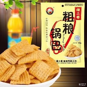 休闲零食 厂家批发 傻二哥粗粮锅巴麻辣味100g包 膨化食品